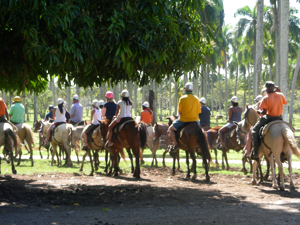 Employees on a horse back riding trail ride in Punta Cana