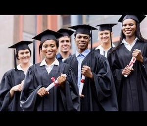 UNCF students in cap and gown with diplomas